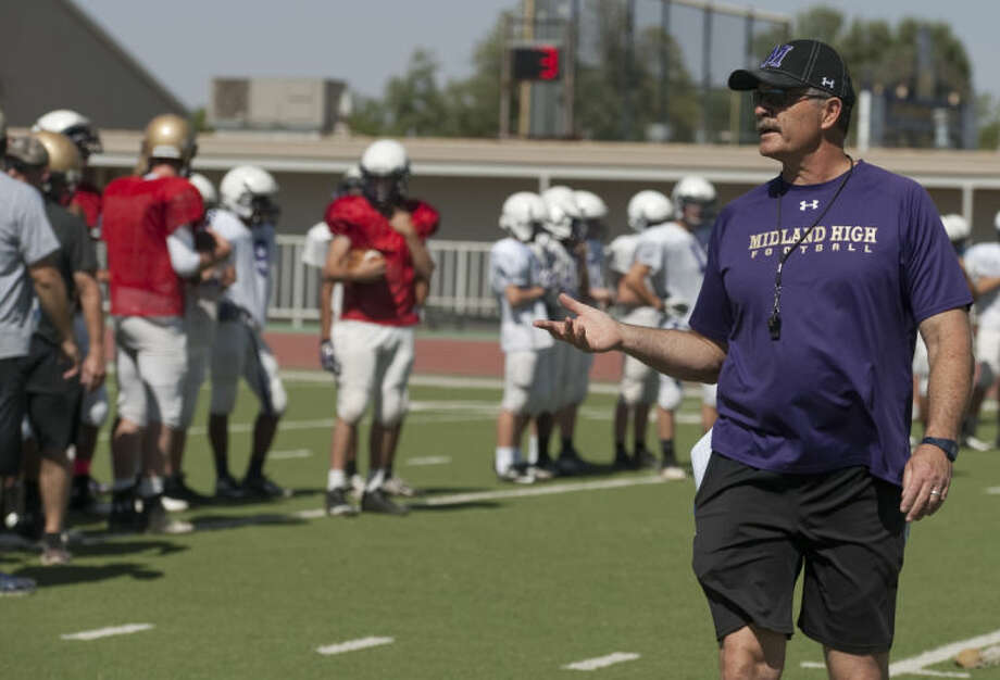 Midland High coach Craig Yenzer talks with his players as they run drills Monday on the first day of Spring football practice. Tim Fischer\Reporter-Telegram Photo: Tim Fischer