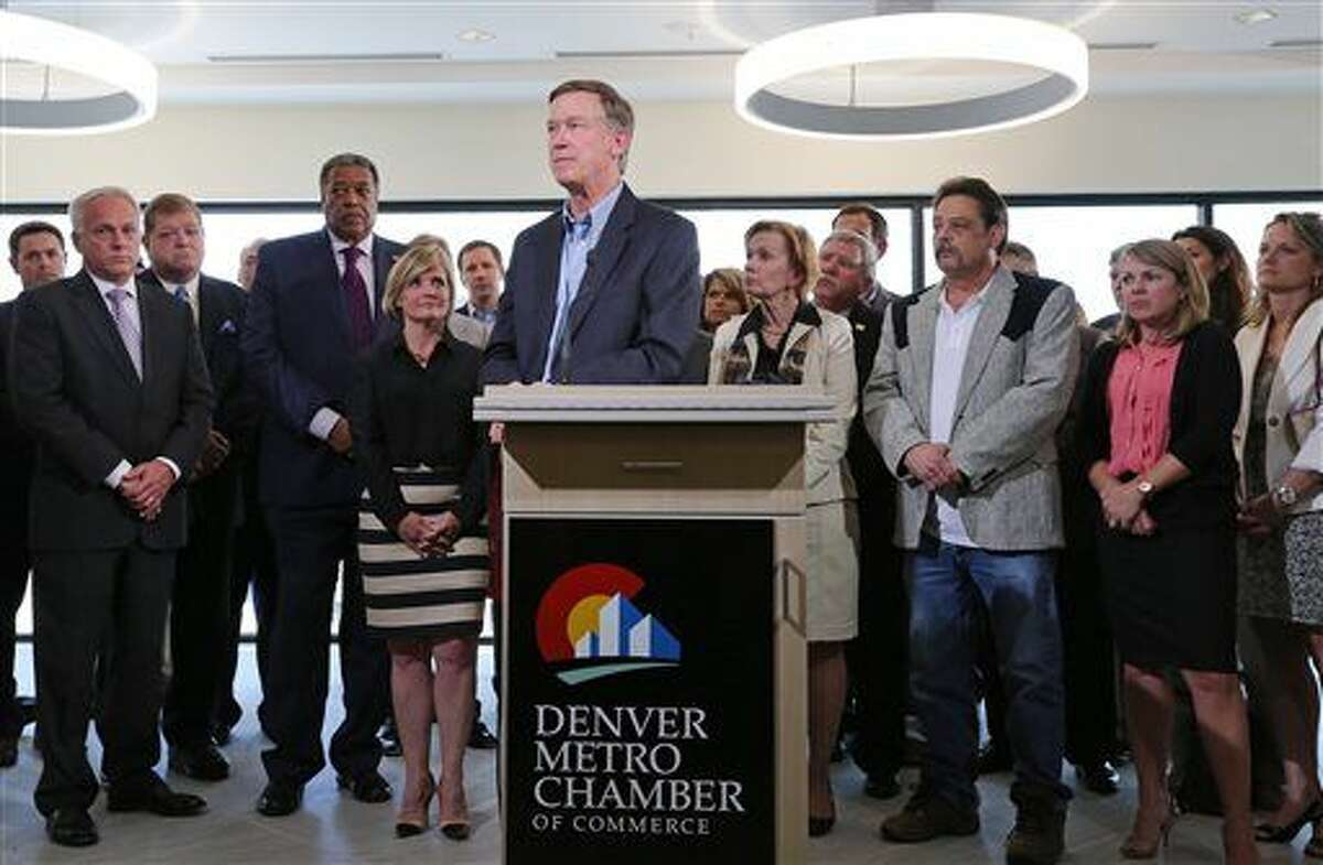 Colo. Gov. John Hickenlooper speaks on oil and gas drilling at the Metro Denver Chamber of Commerce, Thursday, July 17, 2014. Hickenlooper spoke about his opposition to proposed Colorado ballot measures to limit hydrocarbon extraction. The oil and gas industry says those measures would ban drilling, though supporters of the ballot measures disagree. (AP Photo/Brennan Linsley)