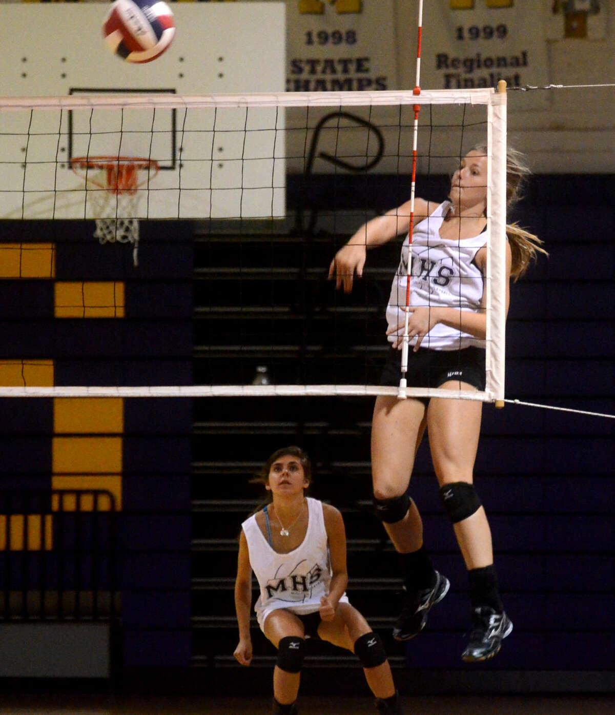 Midland High's Jenna Gillean hits during practice Wednesday at MHS. James Durbin/Reporter-Telegram