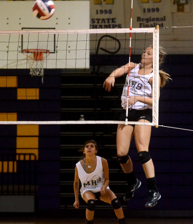 Midland High's Jenna Gillean hits during practice Wednesday at MHS. James Durbin/Reporter-Telegram Photo: James Durbin