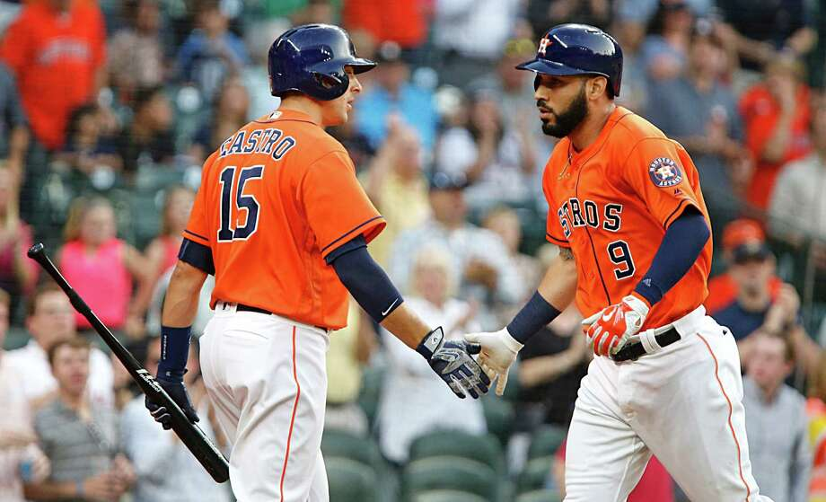 Houston Astros first baseman Marwin Gonzalez right, shakes hands with Astros catcher Jason Castro left, after hitting a home run against the Seattle Mariners during the second inning of MLB game action at Minute Maid Park Friday, May 6, 2016, in Houston. Photo: James Nielsen, Houston Chronicle / © 2016  Houston Chronicle