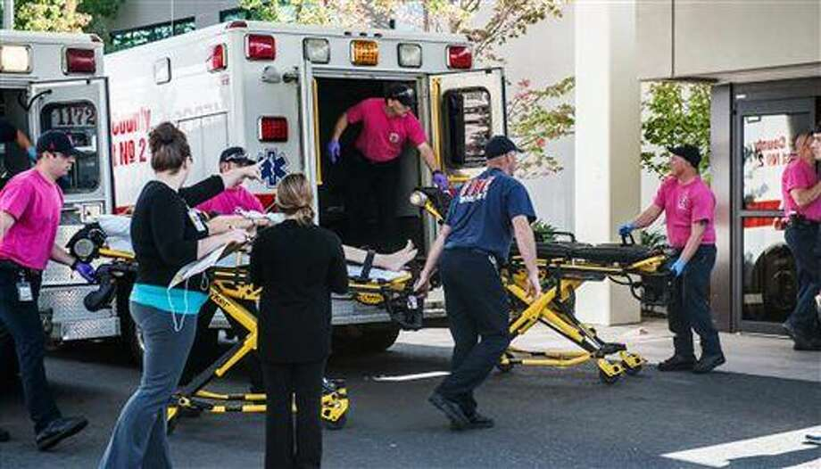 A patient is wheeled into the emergency room at Mercy Medical Center in Roseburg, Ore., following a deadly shooting at Umpqua Community College, in Roseburg, Thursday, Oct. 1, 2015. (Aaron Yost/Roseburg News-Review via AP) Photo: Aaron Yost
