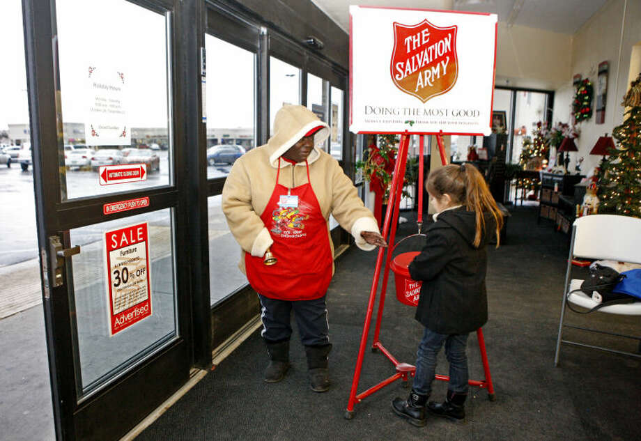 In this file photo, Salvation Army of Midland bell-ringer Vickie McGrew accepts a donation from Laura Worsham, age 6, at Hobby Lobby on Thursday. James Durbin/Reporter-Telegram Photo: JAMES DURBIN