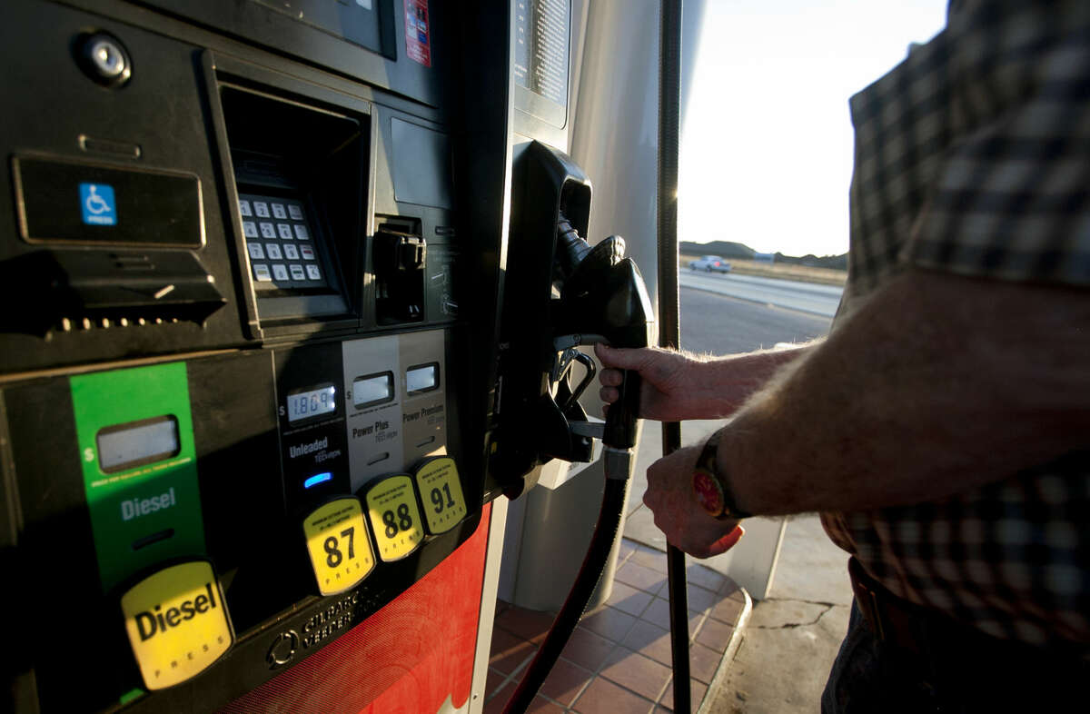 Louis Brewer fills up for $1.80 at the Kent Quick on Briarwood and Northcrest before heading home to Andrews on Monday, Sept. 14, 2015. James Durbin/Reporter-Telegram