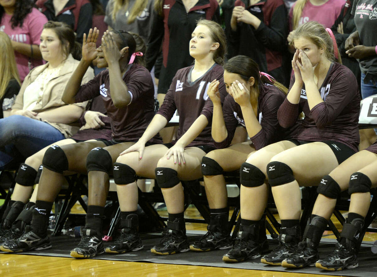 Lee High volleyball players react to a three game shutout from Midland High on Friday, Oct. 2, 2015 at Lee High. James Durbin/Reporter-Telegram