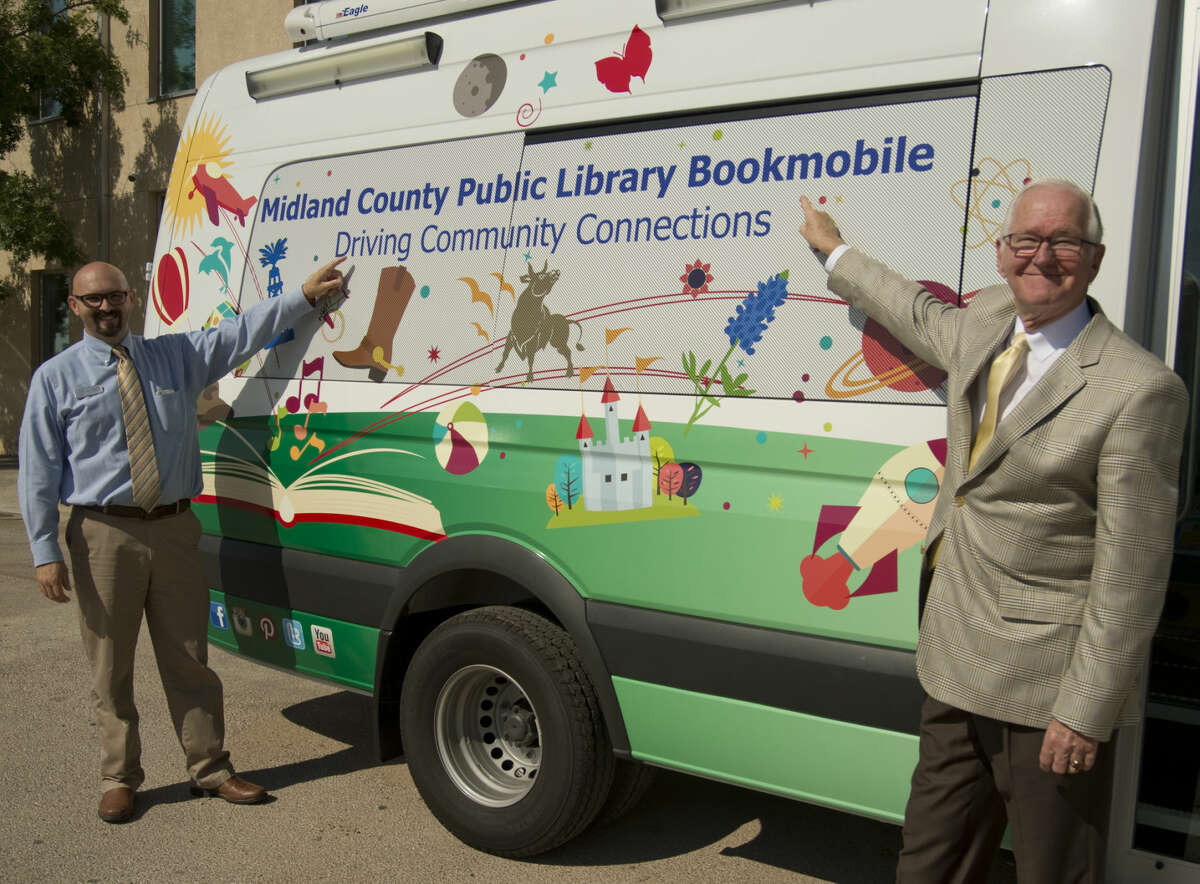 John Trischitti, with Midland County Libraries and Judge Mike Bradford, Midland County Judge, show off the new bookmobile Wednesday 8-26-2015. Tim Fischer\Reporter-Telegram