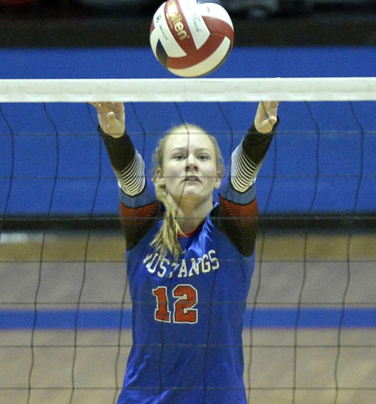 Midland Christian's Megan Ashton (12) sets the ball against Grapevine Faith on Saturday, Oct. 3, 2015, at McGraw Events Center. James Durbin/Reporter-Telegram