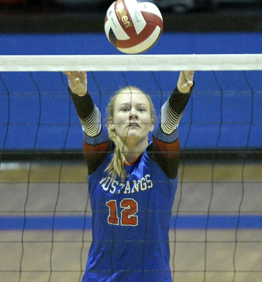 Midland Christian's Megan Ashton (12) sets the ball against Grapevine Faith on Saturday, Oct. 3, 2015, at McGraw Events Center. James Durbin/Reporter-Telegram Photo: James Durbin