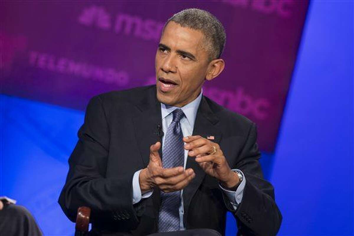 FILE - In this Feb. 25, 2015, file photo, President Barack Obama speaks during a town hall meeting on immigration hosted by Telemundo and MSNBC, at Florida International University in Miami. New government figures show deportations of immigrants in the United States illegally have declined for the third consecutive year. The figures obtained by The Associated Press show that the Obama administration deported just over 231,000 people during the past 12 months ending September 28. (AP Photo/Evan Vucci)