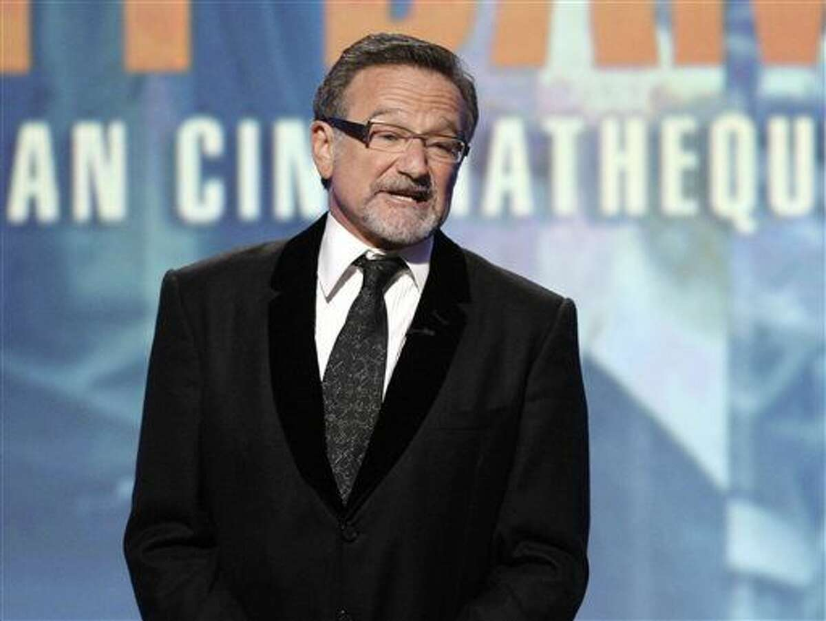 FILE - This March 27, 2010 file photo shows actor Robin Williams speaking at The 24th American Cinematheque Awards honoring Matt Damon in Beverly Hills, Calif. Williams, whose free-form comedy and adept impressions dazzled audiences for decades, has died in an apparent suicide. He was 63. The Marin County Sheriff's Office said Williams was pronounced dead at his home in California on Monday, Aug. 11, 2014. The sheriff's office said a preliminary investigation showed the cause of death to be a suicide due to asphyxia.(AP Photo/Dan Steinberg, File)