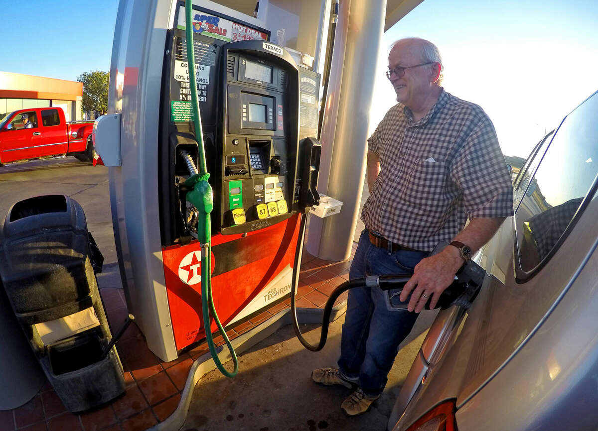 Louis Brewer fills up for $1.80 per gallon at the Kent Quick on Briarwood and Northcrest before heading home to Andrews on Monday, Sept. 14, 2015. James Durbin/Reporter-Telegram