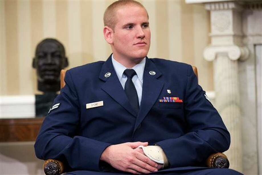 FILE - In this Sept. 17, 2015 file photo, Air Force Airman 1st Class Spencer Stone sits in the Oval Office of the White House during a meeting with President Barack Obama in Washington. An Air Force spokesman said on Thursday, Oct. 8, 2015, that Stone, who helped subdue an attacker on a Paris-bound train in August, is in stable condition after being stabbed in California. (AP Photo/Andrew Harnik, File) Photo: Andrew Harnik