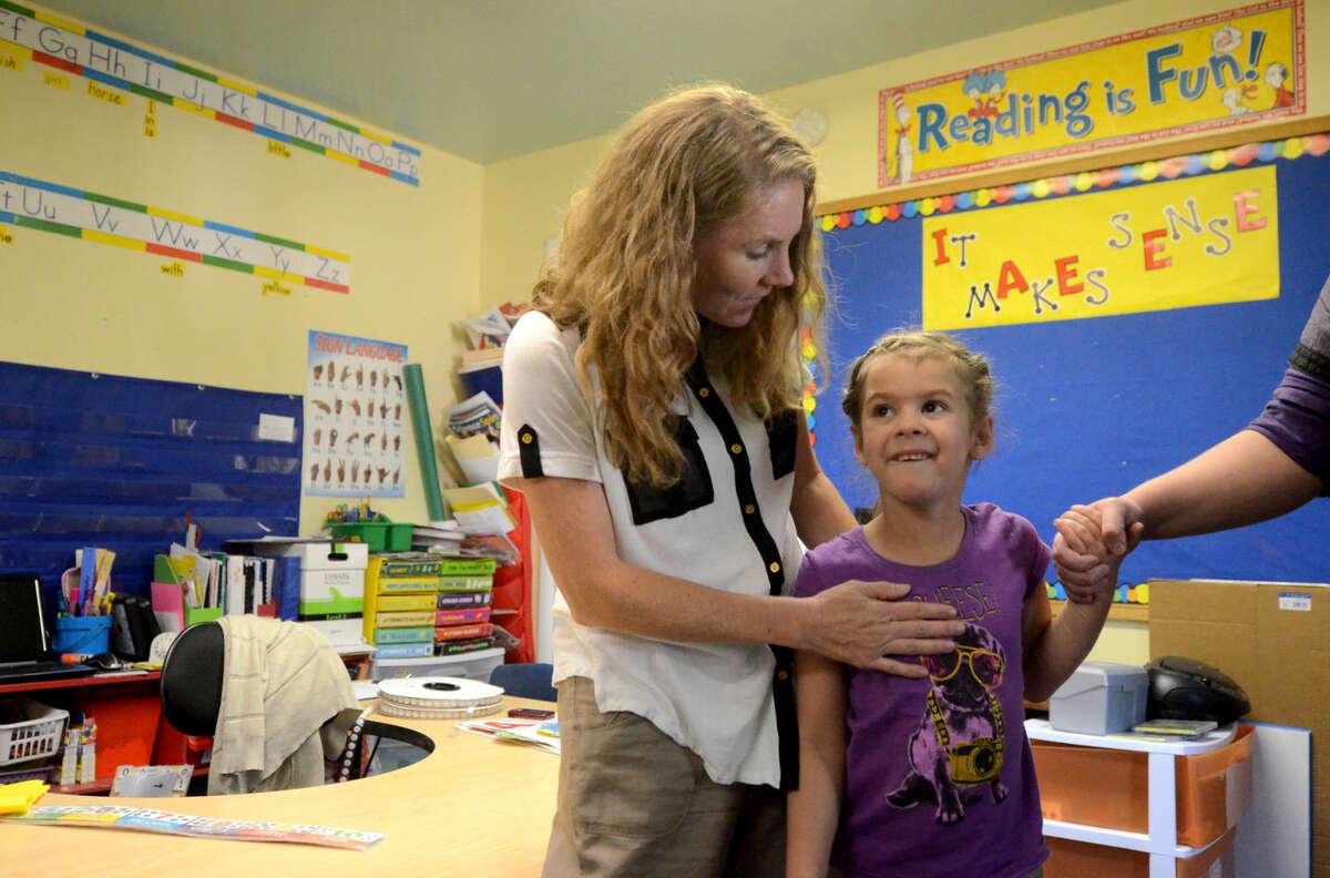 "Kari Lynn Shattenberg, primary elementary teacher, talks to Leslie Munoz, age 6, during ""Meet The Teacher"" night Wednesday at the Bynum School. James Durbin/Reporter-Telegram"