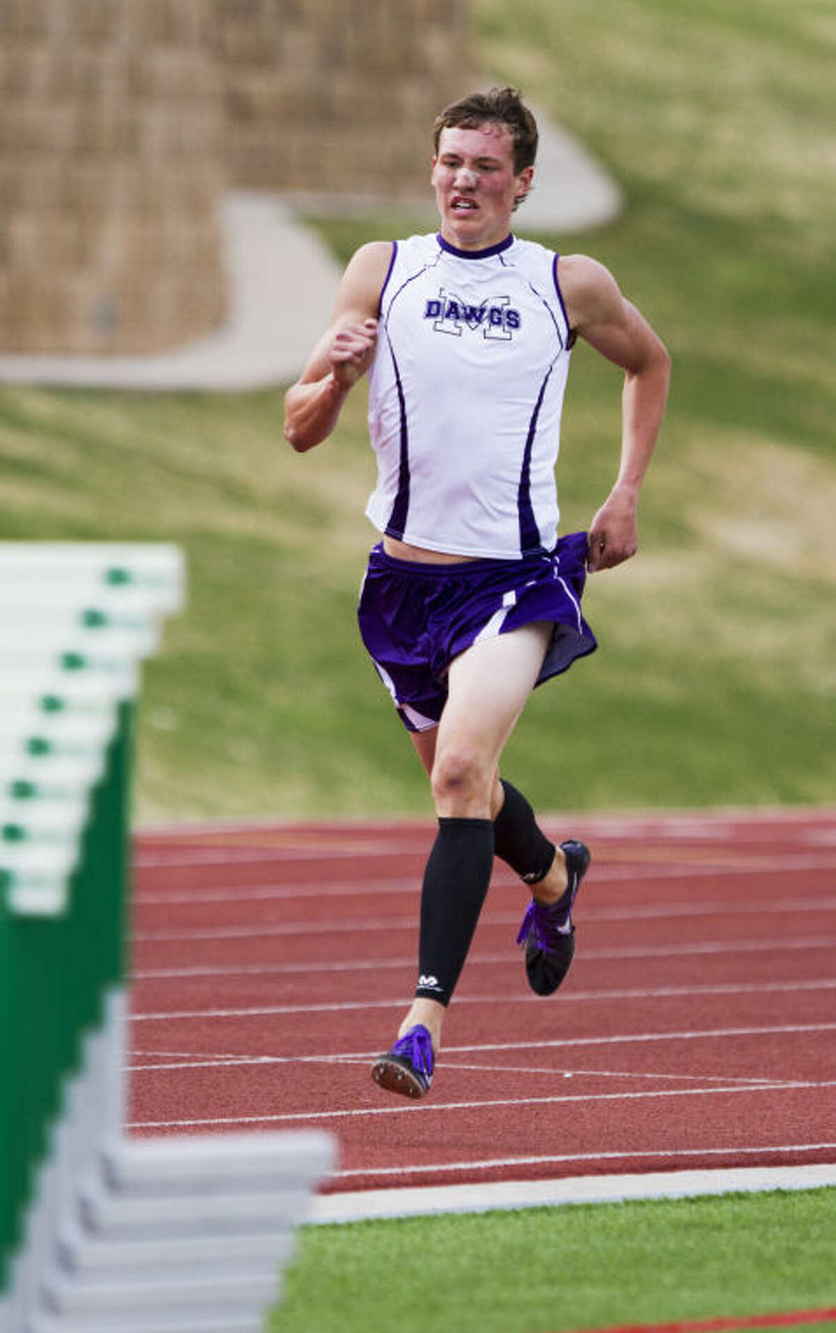 Midland's Austin Watson runs down the track during the 1,600 meter run during the UIL District 2-5A Track Championship April 11 at Lowrey Field in Lubbock. Watson's 4:32.97 time placed him second in the finals.