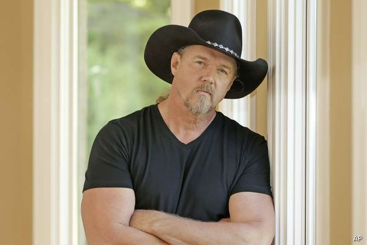 In this May 13, 2013 photo, country singer Trace Adkins and Maureen Maltez rehearse in Brentwood, Tenn. Atkins recently heard Maltez sing at his daughter's dance recital, and asked her to sing with him at an upcoming appearance in New York. (AP Photo/Mark Humphrey)