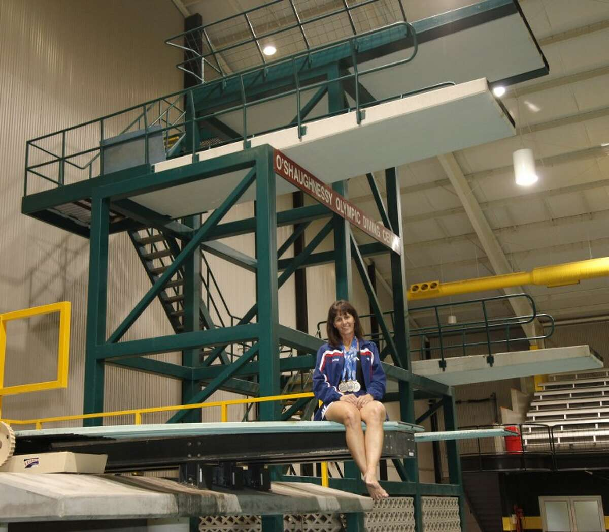 Jennifer Mangum, Midland ISD's head diving and swimming coach, competes at the masters level. The 3-meter dive is her favorite event.