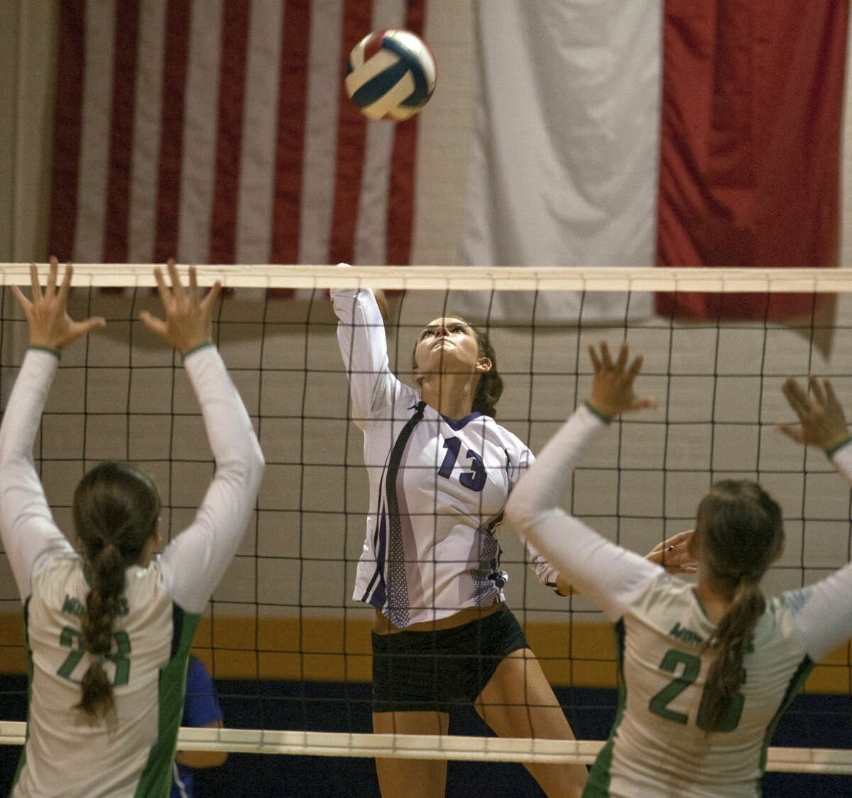 Midland High's Erin Robbins looks to put the ball down between Monahans' Caroline Cutbirth and McKylie Irons Tuesday during a match at MHS. Tim Fischer\Reporter-Telegram