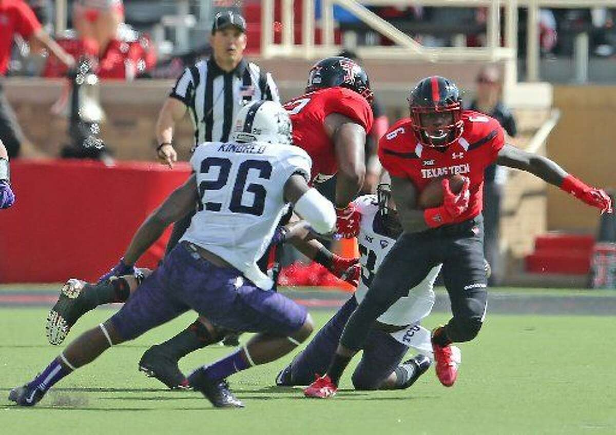 Texas Tech receiver Devin Lauderdale (6) tries to shake loose from a TCU defender in a game on Sept. 26 in Lubbock.