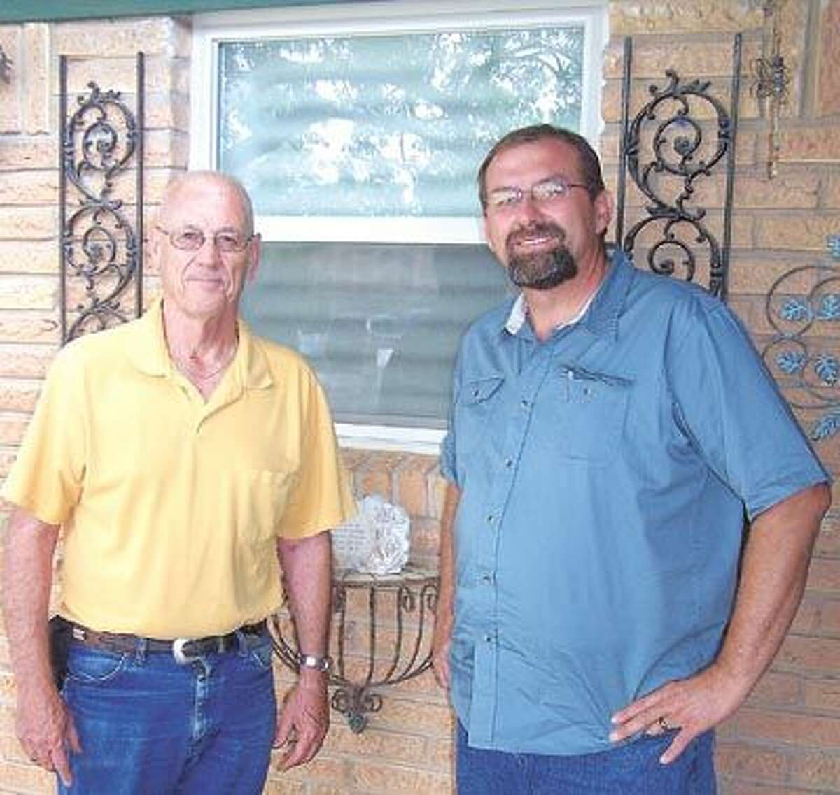Midland homeowner Stan Sartain (left) says he and his wife really enjoy their home's insulated windows, installed by Neil Letkeman of Lifetime Windows. Call Neil at 580-8125 for a free estimate.