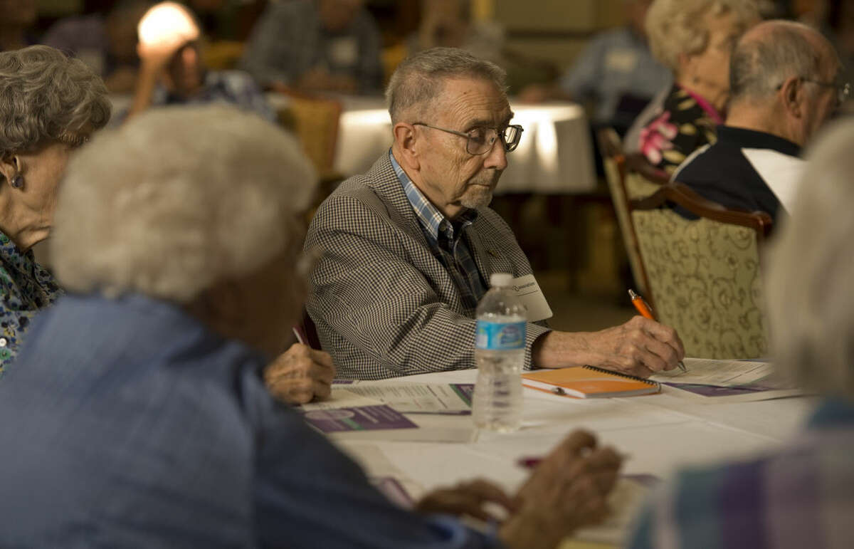 Residents of Manor Park, area residents as well as family members touched by Alzheimers listen and take notes Monday 9-21-2015 at a panel discussion on the state of Alzheimers in Cowden Clubhouse in ManorPark. Tim Fischer\Reporter-Telegram