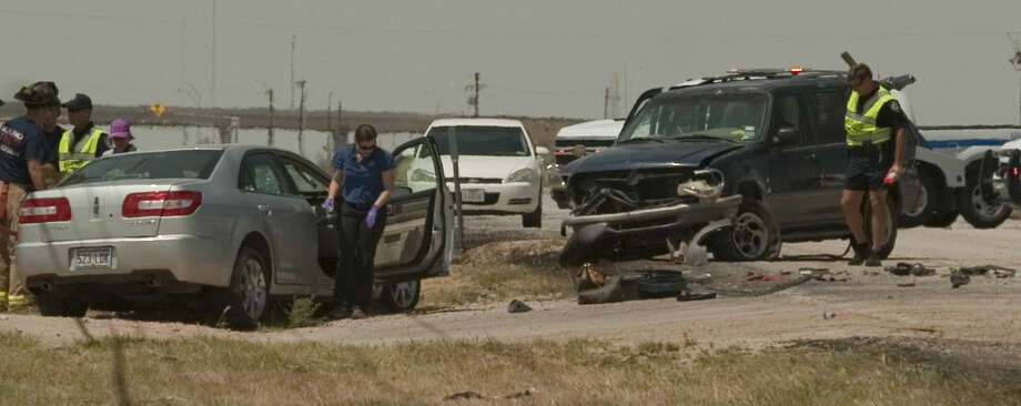 Officials investigate a fatal accident on 1788 Thursday afternoon. Tim Fischer\Reporter-Telegram Photo: Tim Fischer