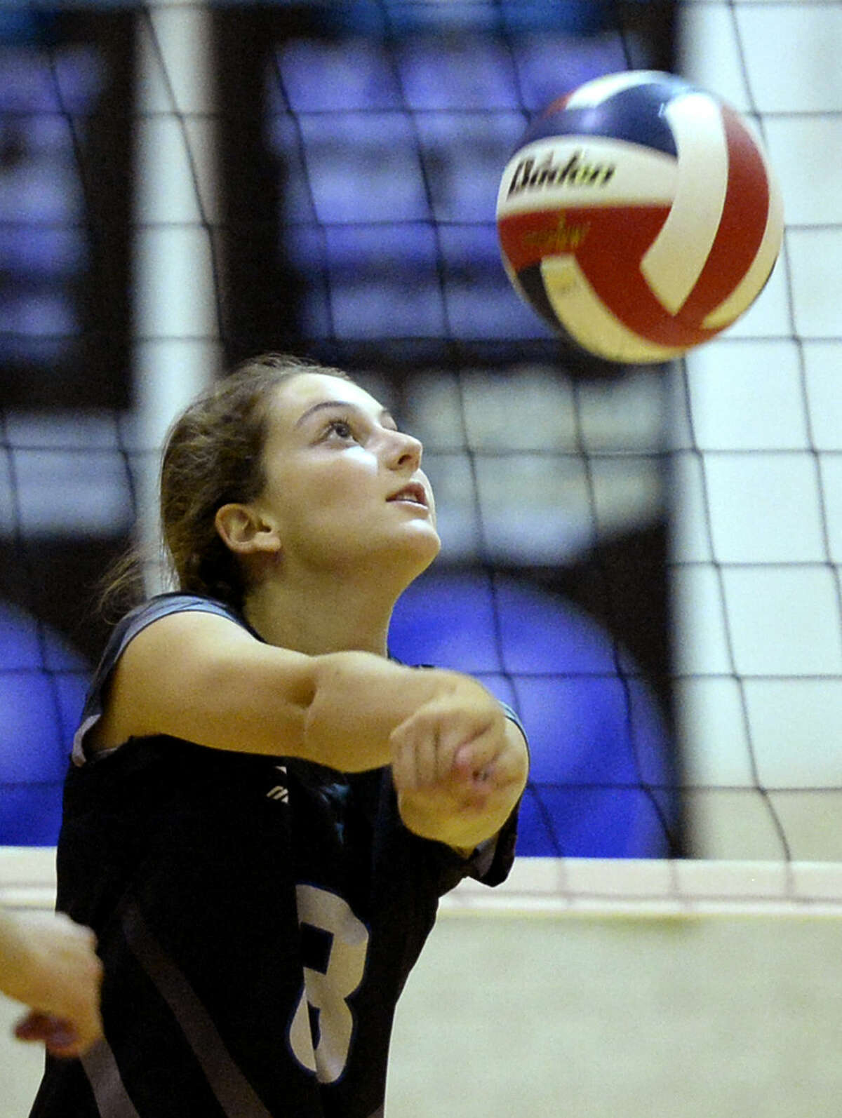 Trinity's Kinzie Roemer (8) sets the ball against Greenwood on Tuesday, Sept. 8, 2015, at Greenwood High. James Durbin/Reporter-Telegram