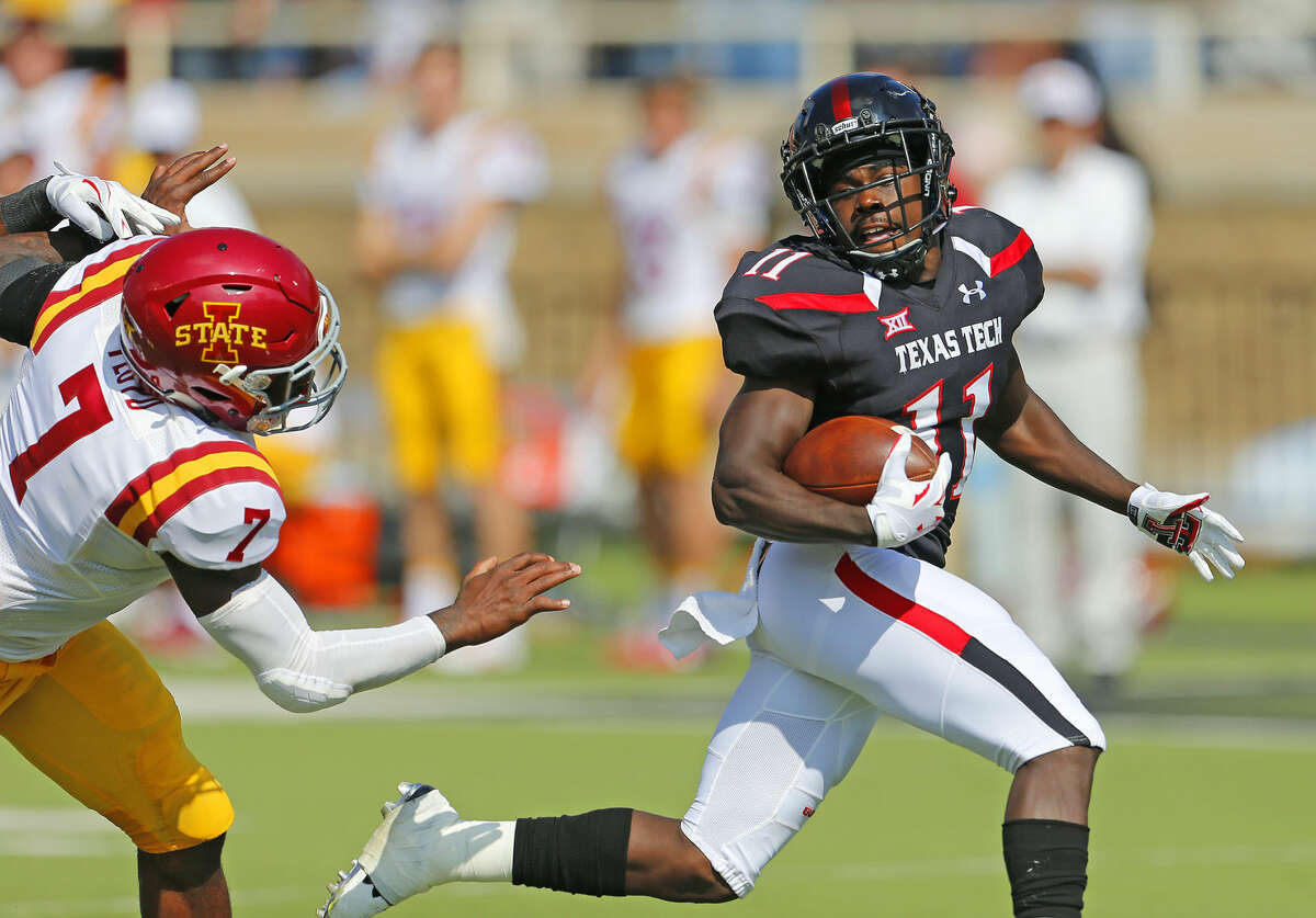 Red Raider receiver Jakeem Grant (11) speeds past an Iowa State defender as he races for a Texas Tech touchdown in Saturday's Big 12 game.