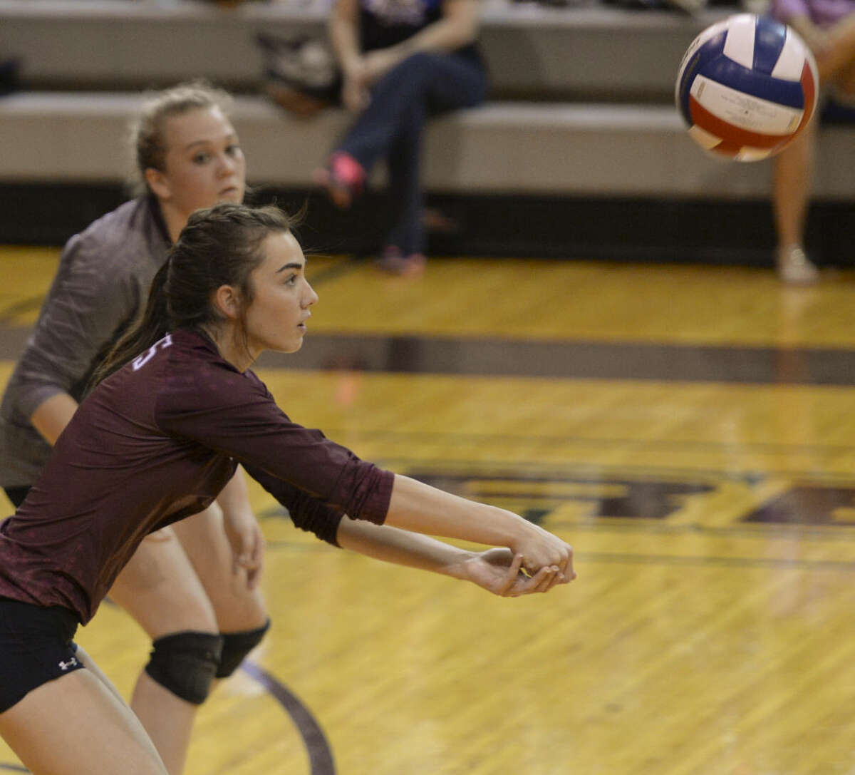 Lee's Taylor Hopkins get set for a bump Tuesday 10-6-2015 as they battle Abilene High at Lee Gymnasium. Tim Fischer\Reporter-Telegram
