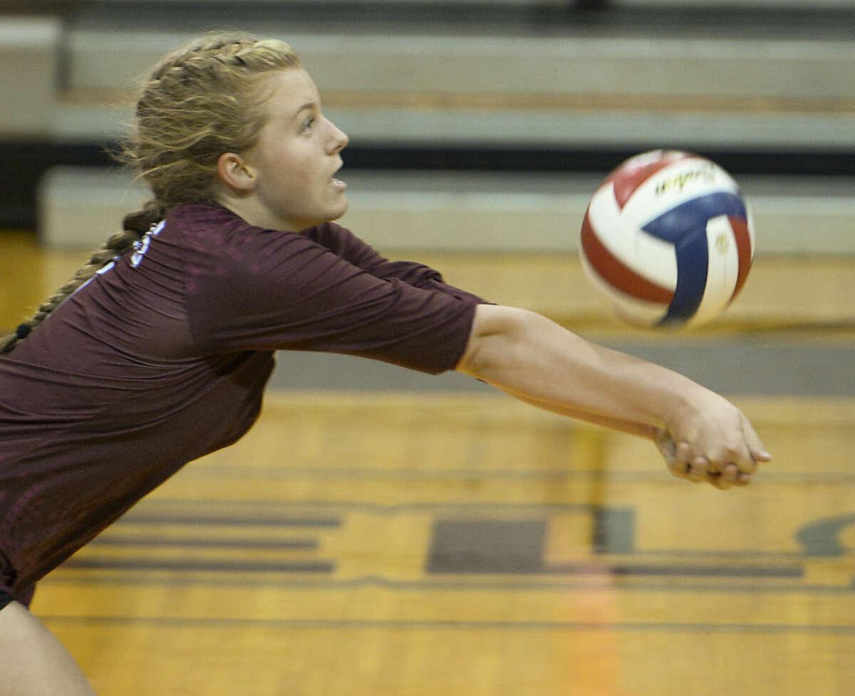Lee High's Emily Hillman gets down for a bump Tuesday 10-6-2015 against Abilene High at Lee High Gym. Tim Fischer\Reporter-Telegram