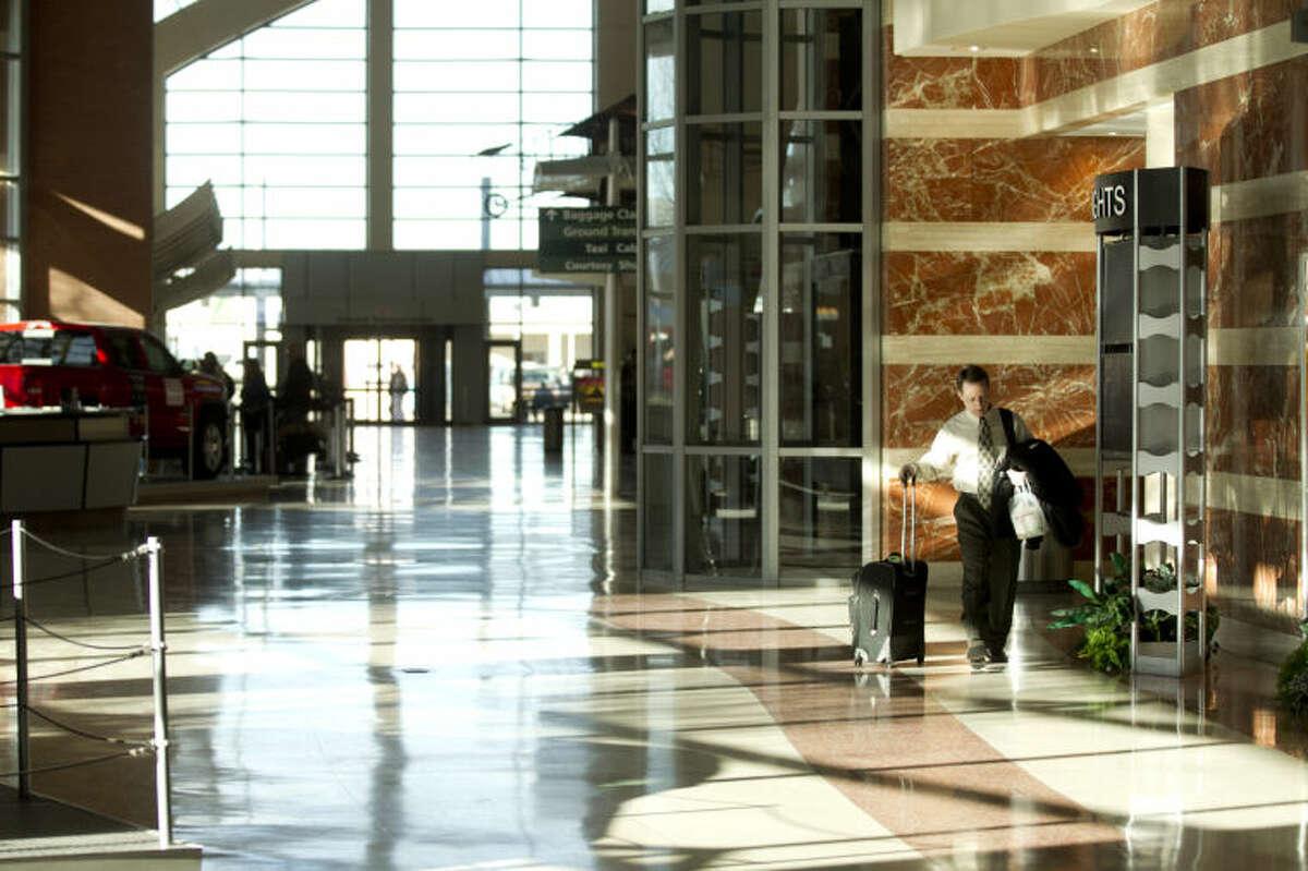 A traveler walks through the ticketing lobby of Midland International Airport, Feb. 13, 2014. James Durbin/Reporter-Telegram