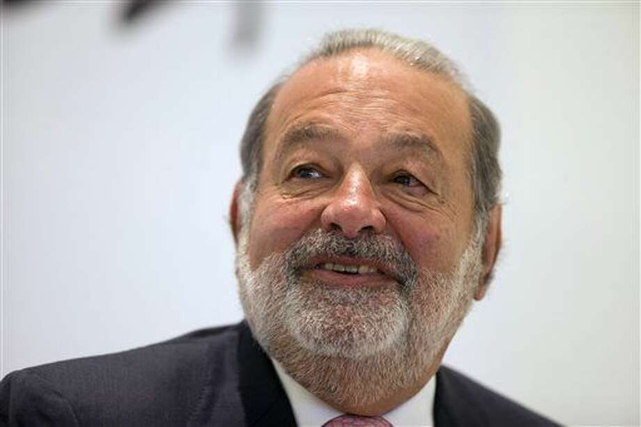 FILE - In this Jan. 14, 2013 file photo, Mexican telecommunications tycoon Carlos Slim speaks during news conference at the Soumaya museum in Mexico City. Slim is scheduled to give the closing speech on Sunday, Aug. 17, 2014, at the annual conference of the Catholic Association of Latino Leaders. (AP Photo/Dario Lopez-Mills, File) Photo: Dario Lopez-Mills