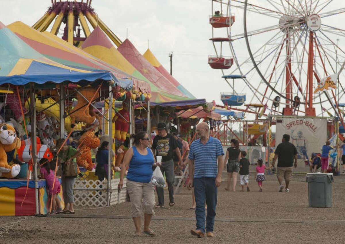 Fair goers make their way around the grounds Saturday at the Midland County Fair. Tim Fischer\Reporter-Telegram