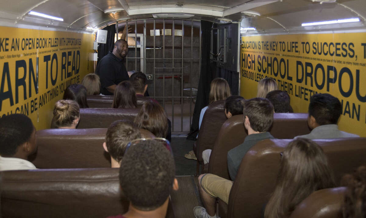 Chris Rice, with Mattie C. Stewart Foundation, talks to Lee Freshman students Friday 10-9-2015 after they watched a video on making the right choices and staying in school before viewing a prison cell on the back of the Choice Bus to show what their option is if they drop out of school and make bad decisions. Tim Fischer\Reporter-Telegram
