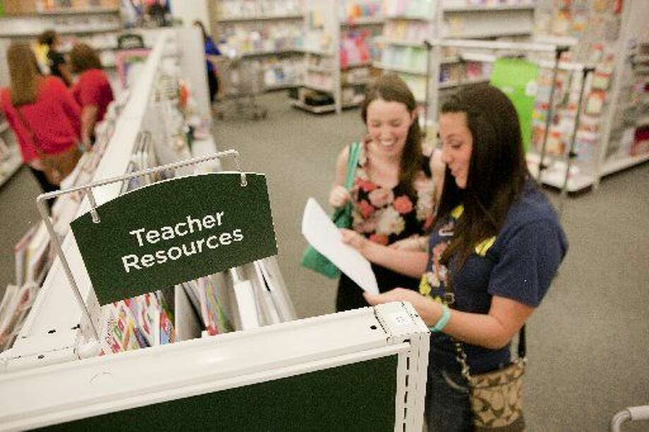 Allison Dyer, left, a Junior League member, shops with Chelsea Carwile, right, a first-year P.E. teacher at Travis Elementary on Tuesday at Mardel Christian and Education Supply. The Junior League of Midland gave nine first-year teachers $200 to go shopping for classroom decorations. Photo: James Durbin/Reporter-Telegram