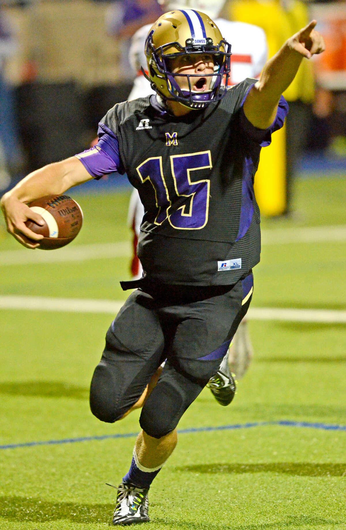 Midland High quarterback Jackson Anuszkiewicz (15) celebrates after scoring against Odessa High on Friday, Oct. 9, 2015, at Grande Communications Stadium. James Durbin/Reporter-Telegram