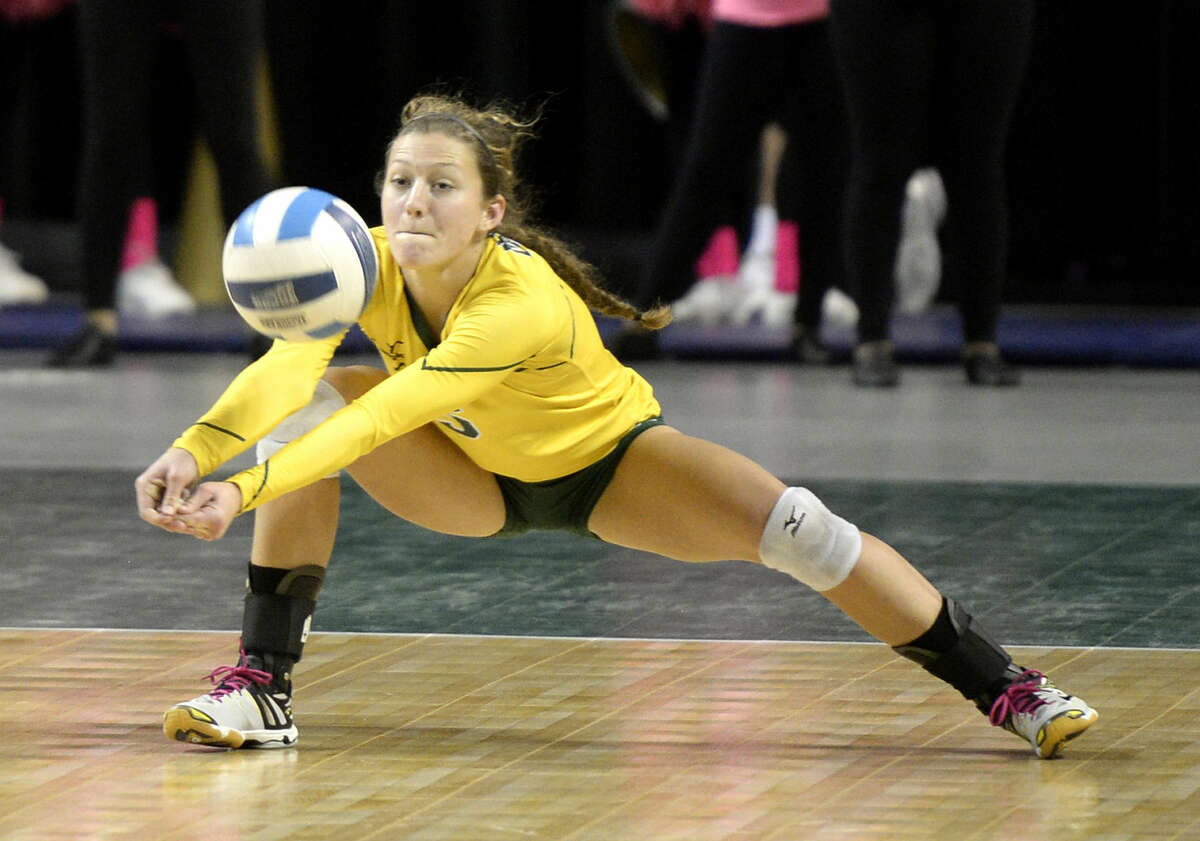 Midland College's DeeAnn Greehey (5) digs against Frank Phillips College on Wednesday, Oct. 7, 2015, at Chaparral Center. James Durbin/Reporter-Telegram