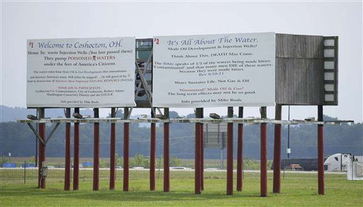 """This Aug. 17 photo provided by Robert A. Franco shows a billboard in Coshocton, Ohio, opposing deep-injection wells. Michael Boals, an Ohio man who uses a biblical reference and a statement against """"poisoned waters"""" on billboards opposing local deep-injection wells is fighting a legal threat from the Texas well owner on grounds he's exercising his free speech.Robert A Franco/Associated Press"""