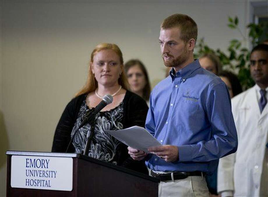 Ebola victim Dr. Kent Brantly speaks as his wife Amber looks on during a news conference after being released from Emory University Hospital., Thursday, Aug. 21, 2014, in Atlanta. John Blazemore/Associated Press Photo: John Bazemore