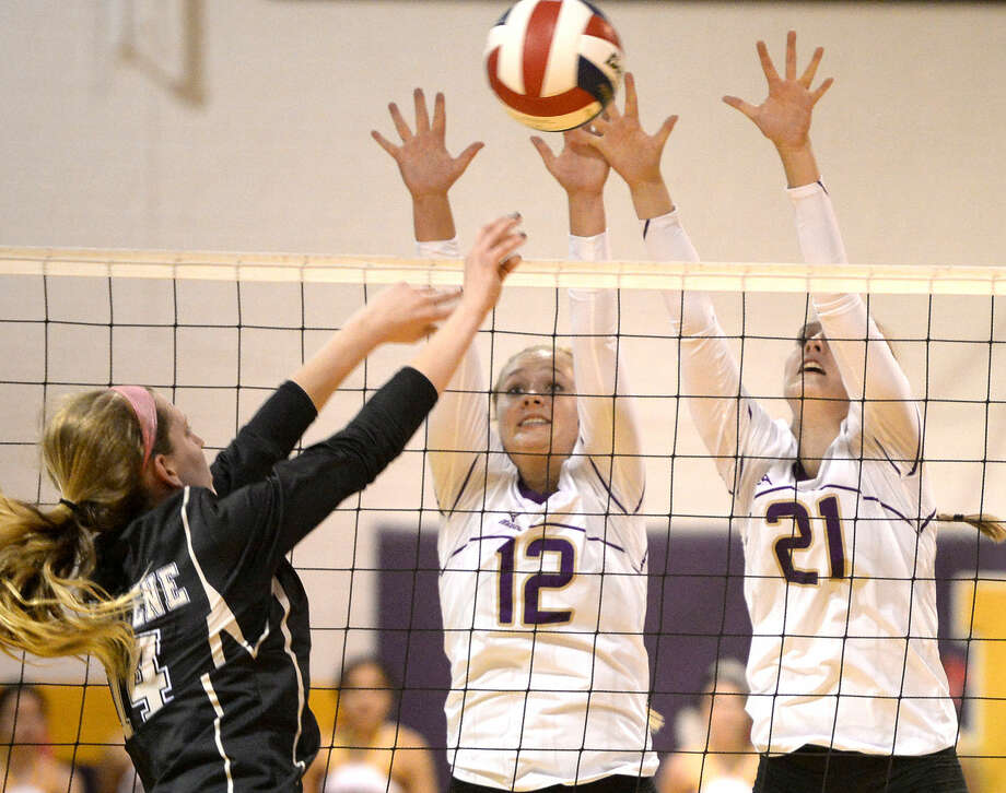 Midland High right side Christen Beckham (12) and middle hitter Krista Epley (21) try to block a hit from Abilene High's Hannah Tawney (14) on Tuesday, Oct. 13, 2015 at Midland High. James Durbin/Reporter-Telegram Photo: James Durbin
