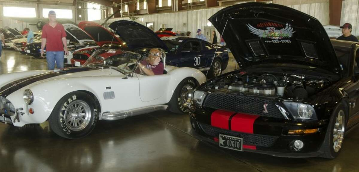 Don Hoffman parks his '65 production 427 AC Cobra in line Saturday with other mustangs from all eras on display at the Mustang Stampede in the CAF hanger. Tim Fischer/Reporter-Telegram