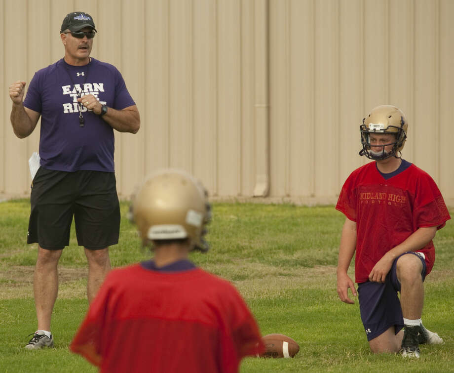 Midland High coach Craig Yenzer works with his quarterbacks during the first day of practice on Aug. 11. Tim Fischer\Reporter-Telegram Photo: Tim Fischer