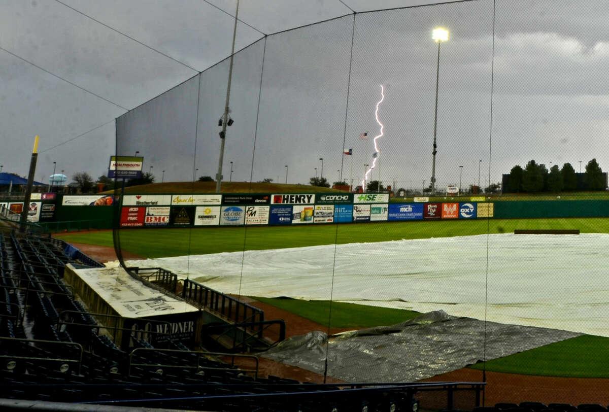 Lightning strikes over Security Bank Ballpark on Wednesday. The Rockhounds game against Corpus Christi was rescheduled due to rain. James Durbin/Reporter-Telegram