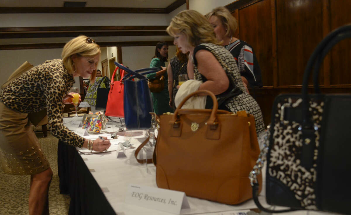 Attendees bid on purses in the silent auction in this 2014 photo before the Power of the Purse luncheon. Tim Fischer\Reporter-Telegram