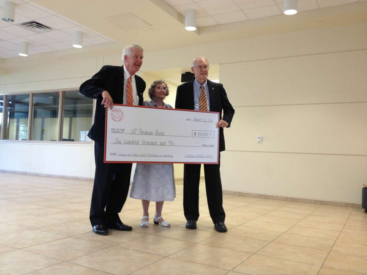 UTPB President David Watts, left, with Ordelle and William Watts, who donated $100,000 to the university to support engineering.