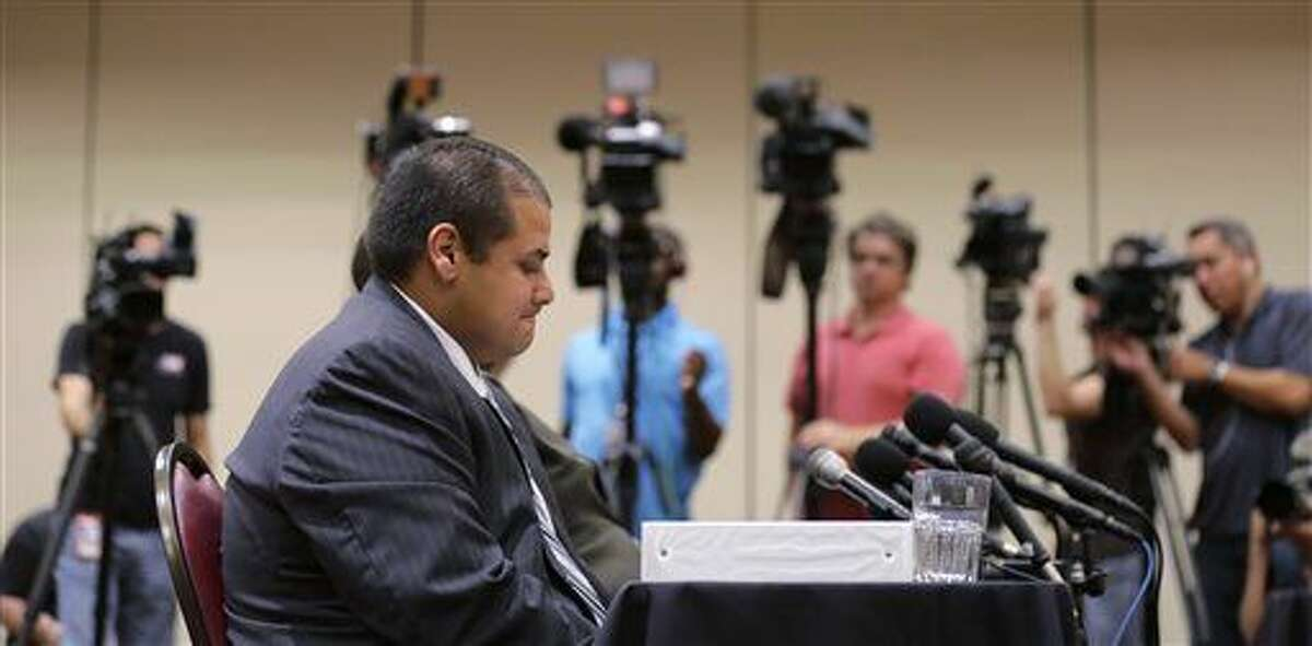 Jay High School head football coach Gary Gutierrez testifies before the University Interscholastic League (UIL) State Executive Committee, Thursday, Sept. 24, 2015, in Round Rock, Texas. The school's principal and Gutierrez told the UIL, the governing body for high school sports in Texas, they believe assistant coach Mack Breed told players to retaliate against an official in the closing minutes of a game earlier this month. (AP Photo/Eric Gay)