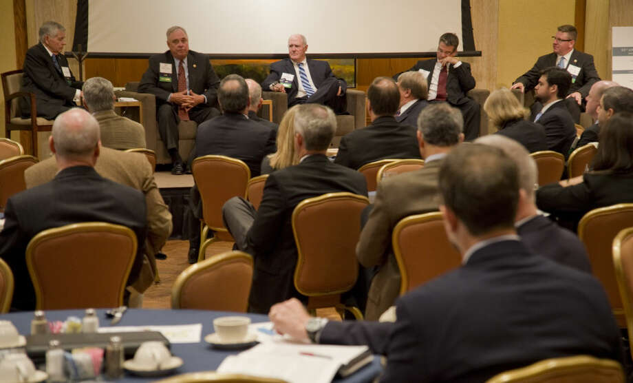 Tom Craddick, left, moderates the Texas Legislative Panel Thursday 10-15-2015 at the Permian Basin Petroleum Association Annual Meeting with Rep. Drew Darby, chairman of House Energy Resources Committee, Sen. Kel Seliger, chairman Senate Higher Education Committee, Sen. Charles Perry, chairman Committee on Agriculture, Water and Rural Affairs and Rep. Tony Dale, chairman House Energy Caucus. Tim Fischer\Reporter-Telegram Photo: Tim Fischer