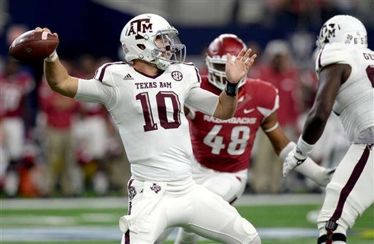 Texas A&M's Kyle Allen looks to pass against Arkansas during an NCAA college football game Saturday, Sept. 26, 2015, in Arlington, Texas. (Sam Craft/The Bryan-College Station Eagle via AP)