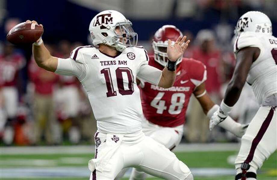 Texas A&M's Kyle Allen looks to pass against Arkansas during an NCAA college football game Saturday, Sept. 26, 2015, in Arlington, Texas. (Sam Craft/The Bryan-College Station Eagle via AP) Photo: Sam Craft