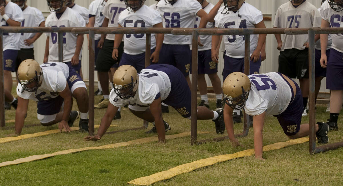 Midland High players run drills during the first day of practice this fall. Tim Fischer\Reporter-Telegram