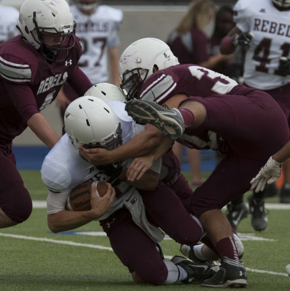 Lee's Jon Schwalbach is stopped by Lee's TJ Soto Friday evening in the Maroon and White scrimage at Grande Communications Stadium. Tim Fischer\Reporter-Telegram